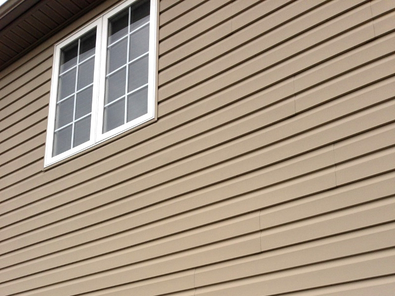 tan vinyl siding wall section