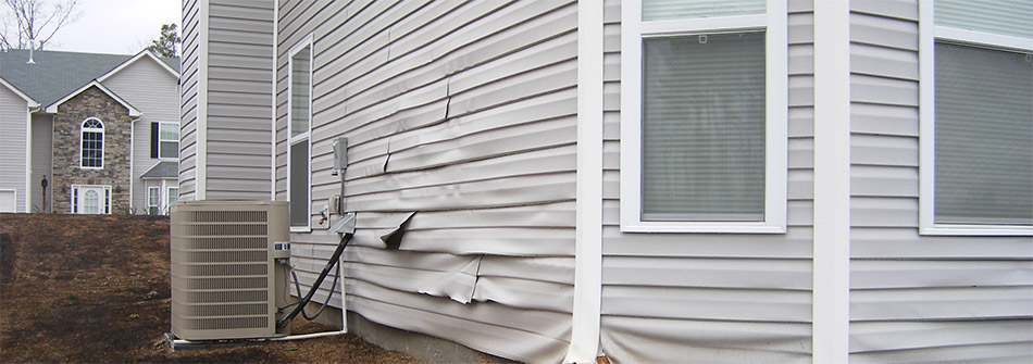 warped light gray vinyl siding