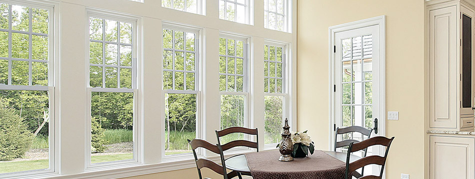 large double hung windows in kitchen area with dining table