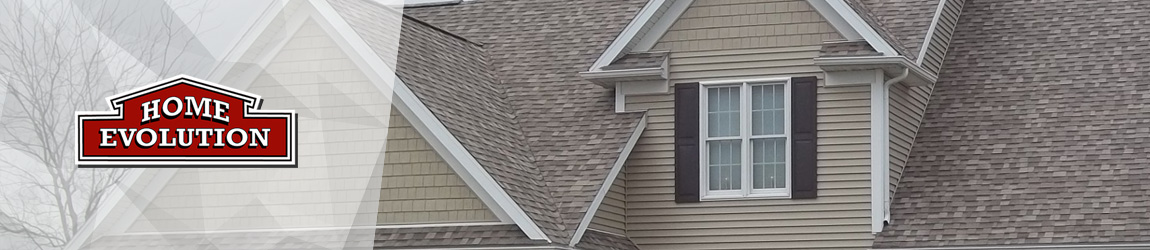 brown architectural shingles installed with tan vinyl siding