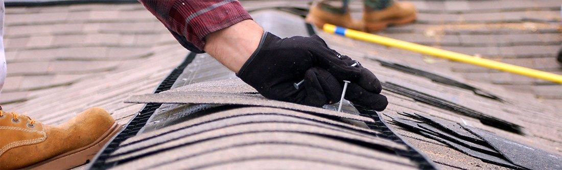 contractor installing ridge vent
