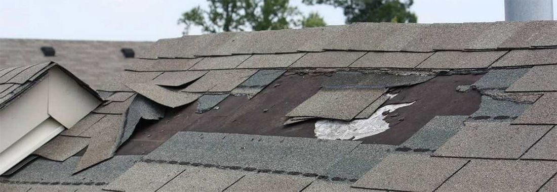 shingles falling off of roof wind damage