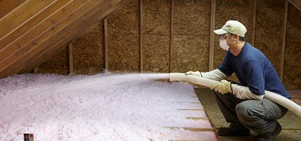 attic insulation albany ny, man spraying pink insulation in attic