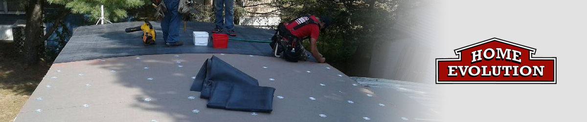 Home Evolution roofing contractor installing EPDM flat rubber roof